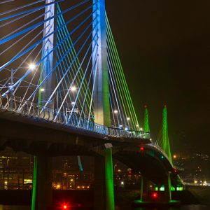 Tilikum Crossing, a new lightrail, bike, and pedestrian bridge in Portland, Oregon lit up at night. USA